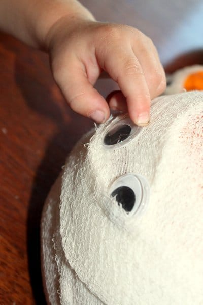 Adding eyes to the pumpkin mummies