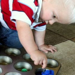 fine motor play with pom poms for toddlers