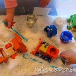 Make a snowy construction site sensory tub with this idea from Things to Share & Remember