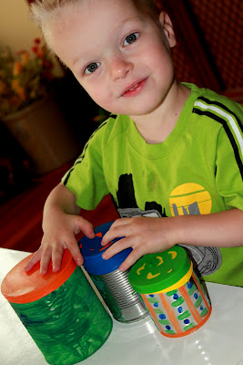 Make easy and colorful DIY tin can drums with your preschooler