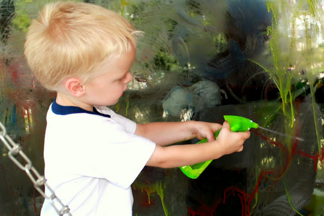 Use a squirt bottle to wash the homemade window paint off afterwards