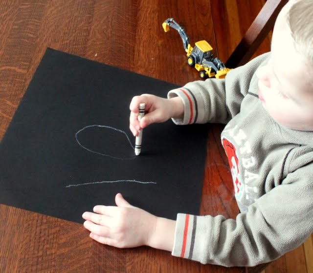 Start your art project by writing or drawing a simple number, like 100, or a simple shape.