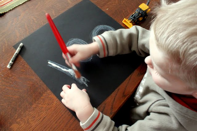 Paint glue over drawing for sand sensory play to stick to.
