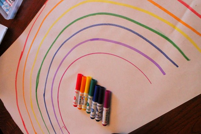 Draw a rainbow to go on a color scavenger hunt for toys to make a rainbow