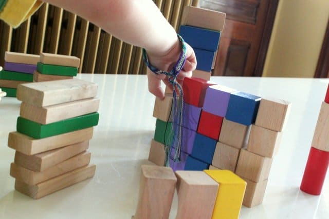 Stacking blocks while sorting them by shape