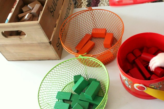 Sorting blocks into colored baskets