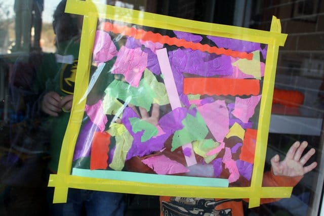 A creative collage for Easter makes a colorful window decoration for spring.