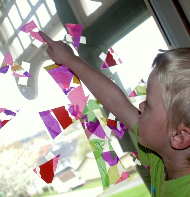 Make a pretty tissue paper cross collage for a kid-friendly Easter craft and window decoration!