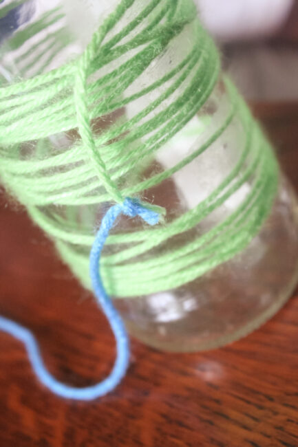 tying off the yarn to add another color to the vase
