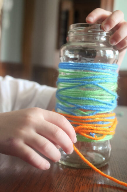 wrapping the yarn around the vase