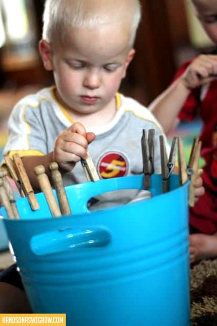 Super simple clothespin activity for toddlers to explore and strengthen their fine motor skills.