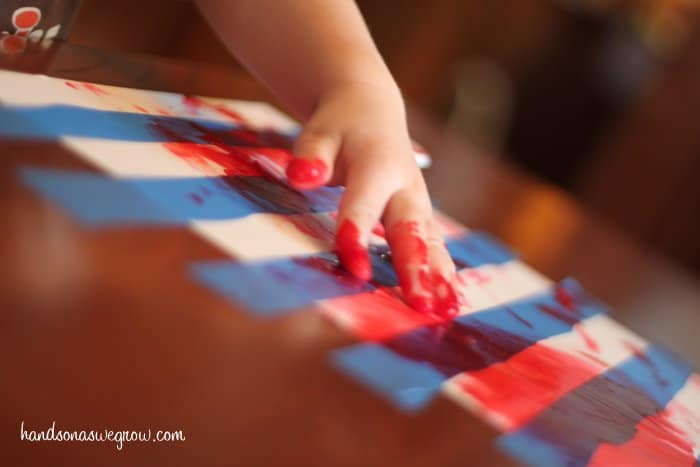 Toddler Tape Resist Painting for Candy Canes!