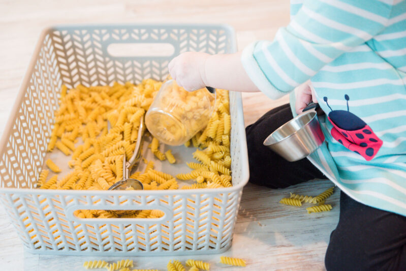 Pasta noodles make for a great sensory bin play time for toddlers and preschoolers. Watch them learn and explore with their sense of touch and even sound.