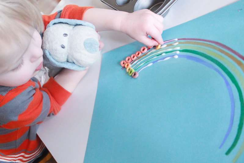 Work on color matching with a cute rainbow cereal craft for kids!