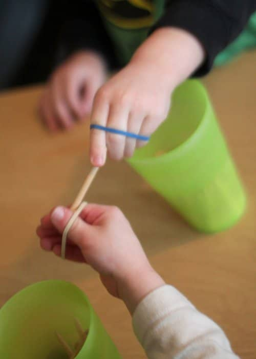 A fine motor activity that focuses on hand strength using rubber bands.