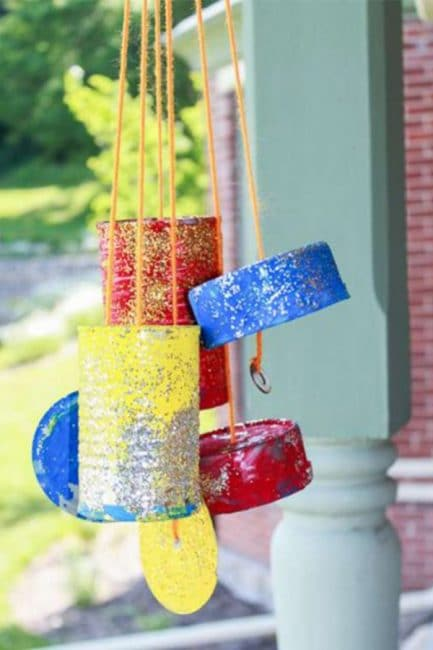 Paint some upcycled tin cans to make a pretty wind chime!