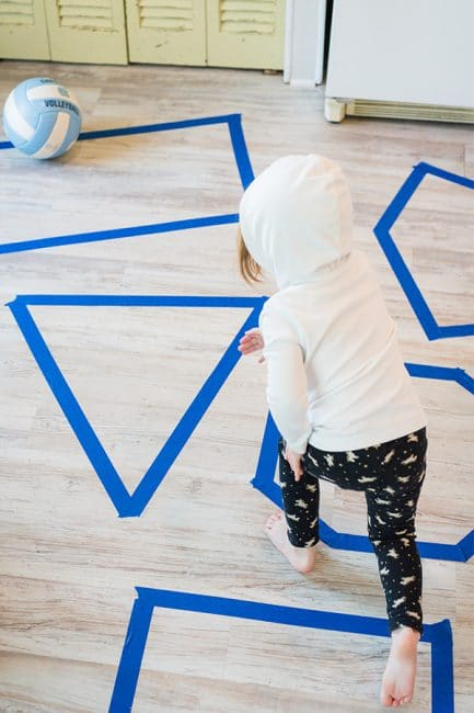Just a little tape and a ball make for a fun shapes learning activity!