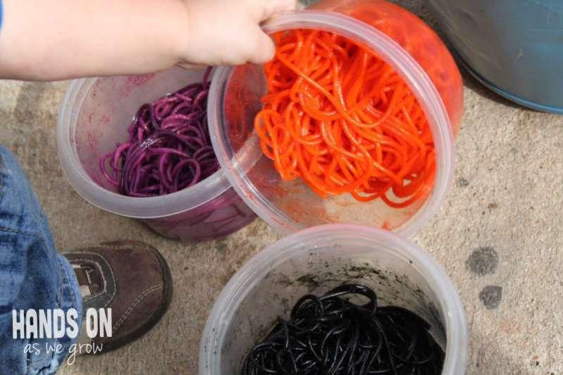Colored slimy spaghetti sensory activity.