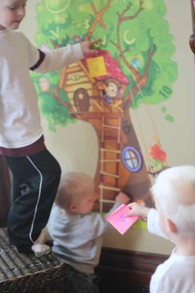 Match the letters on the sticky notes to the searching tree wall decal