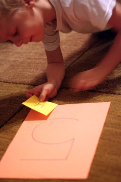 Easy Kindergarten math activity that gets them moving while solving simple addition problems.