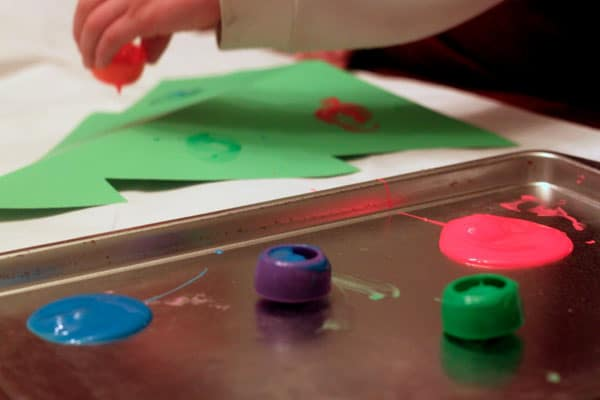 Make a Christmas tree craft with Ella's Kitchen baby food pouch cap painting