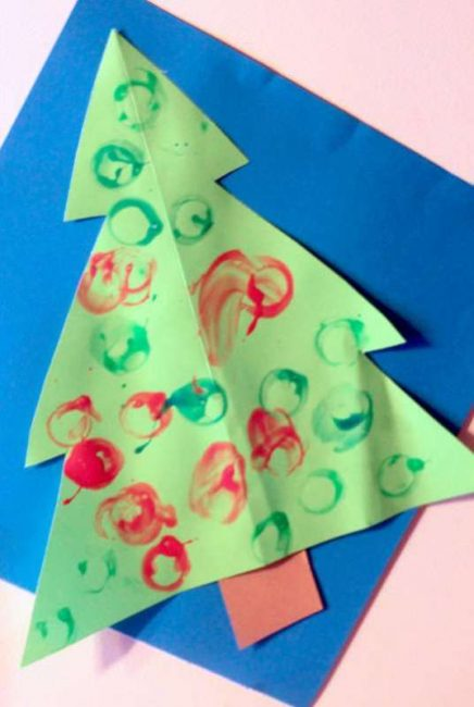 Decorate a Christmas Tree with painted ornaments