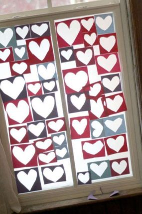 A heart collage window decoration for kids to make