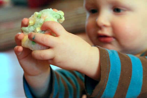 Edible sensory play with frozen veggies for babies and toddlers. So simple!