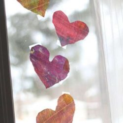 Newsprint watercolor painted hearts to hang on the window for the light to shine through