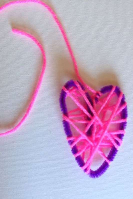 Practice motor skills with this yarn wrapped heart from Bambini Travels' guest post on Hands On As We Grow