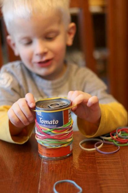 This activity is a great way to keep kids busy - just rubber bands and a soup can from the pantry!