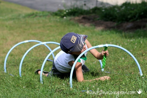 Fort magic tunnel and capture flag in an obstacle course for kids