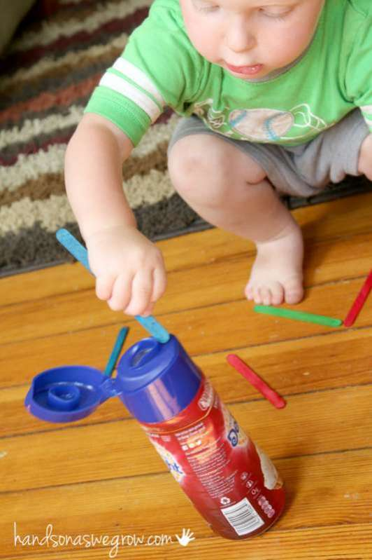Craft Sticks. Much like ribbons, crafts sticks are great entertainment to stick in and pull out of things. Try a bottle with a narrow opening. Or cut slits in the top of a plastic lid.