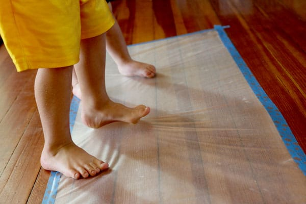 A sticky contact paper sensory activity for toddlers