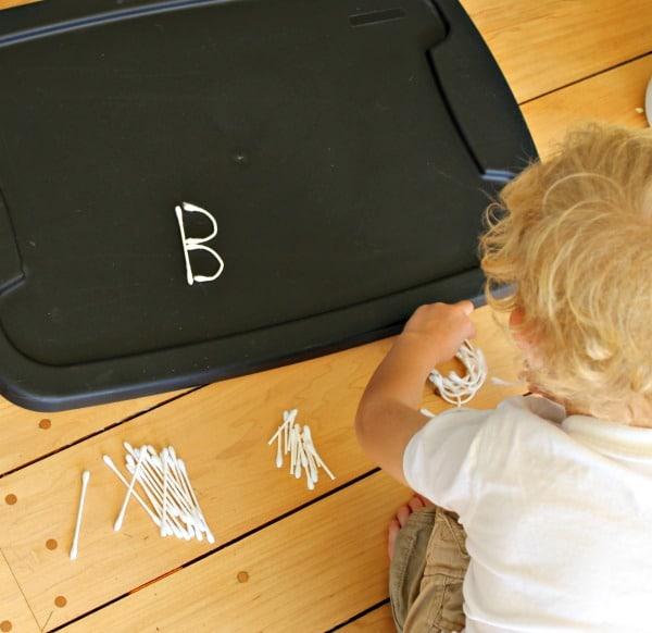 Building Halloween alphabet letters with skeleton bones