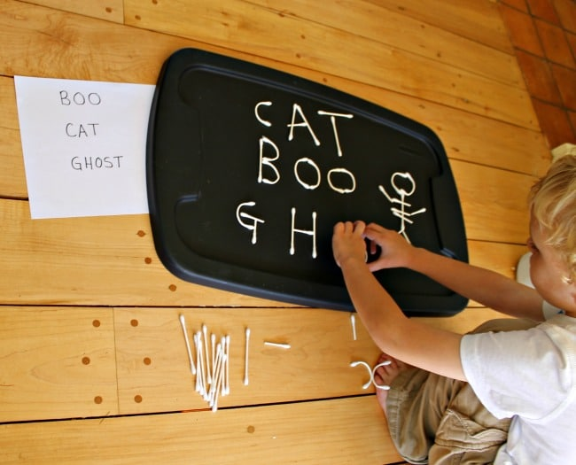 Building and making words with a Halloween alphabet using Q-tips