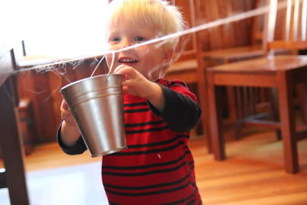 Bucket toddler activity on a clothesline
