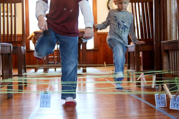 A string obstacle course to get kids moving and learning about numbers (number bonds to 10 and matching numbers)