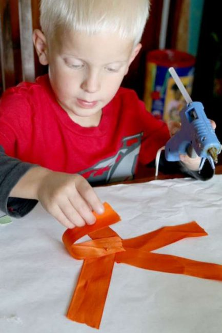Hot glue gun to make ribbon flower bouquet craft