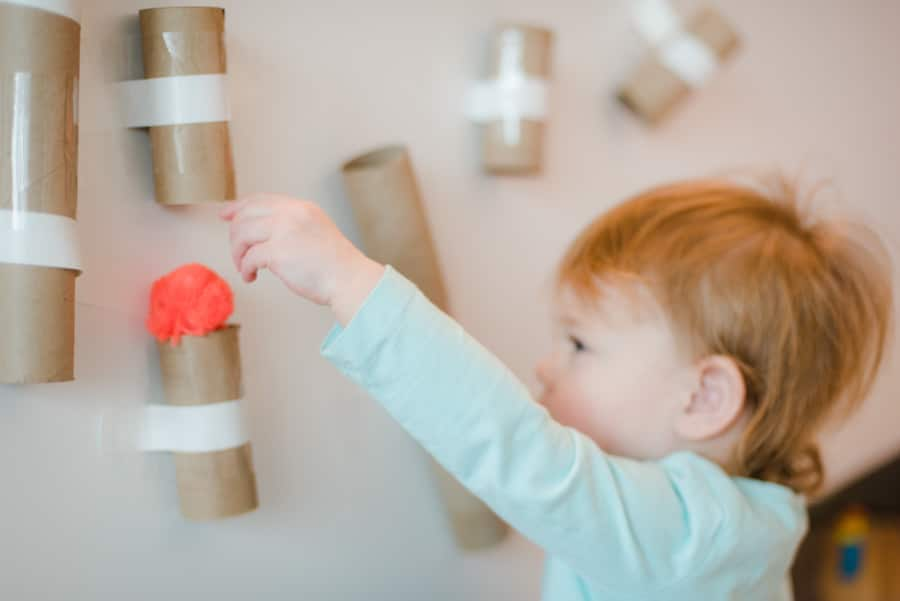 Simple is key with toddlers and this pom pom drop activity is perfect to keep them occupied! Set up is quick and tear down is half the fun!