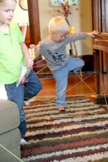 Boys going on the spider web scavenger hunt for Halloween
