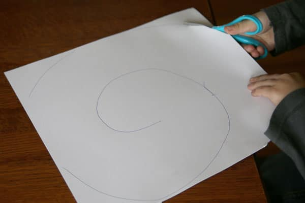 Cutting practice to make spiral ghost craft for Halloween.