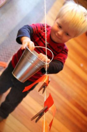 A simple clothesline and bucket activity for toddlers