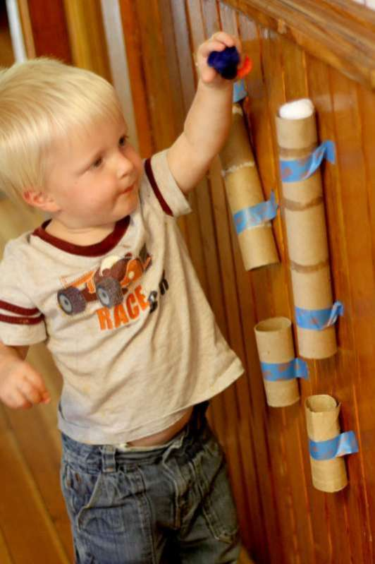 Recycled Tubes. Save paper towel and toilet paper tubes to hang on a wall as something to drop objects through like the pom pom drop. It'll amaze them and keep them busy!