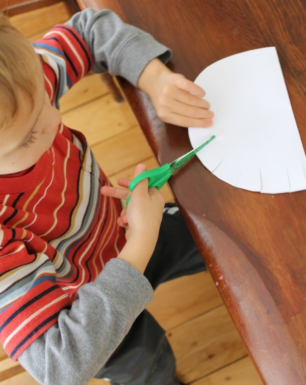 Cutting practice with a Santa craft for preschooler to make
