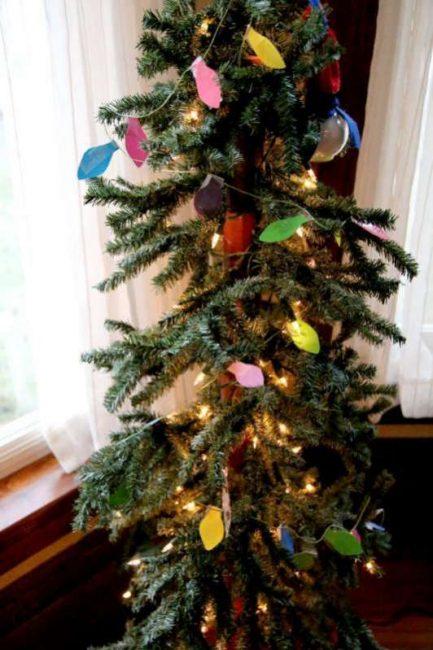 Christmas lights string put on the Christmas tree