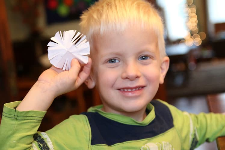 Make snowflakes at Grandma's! One of the simple holiday activities to do with Grandma!