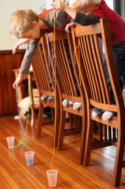 What string do you think will be the easiest to get into the cup? A long one or a shorter one? Amazing coordination activity for kids