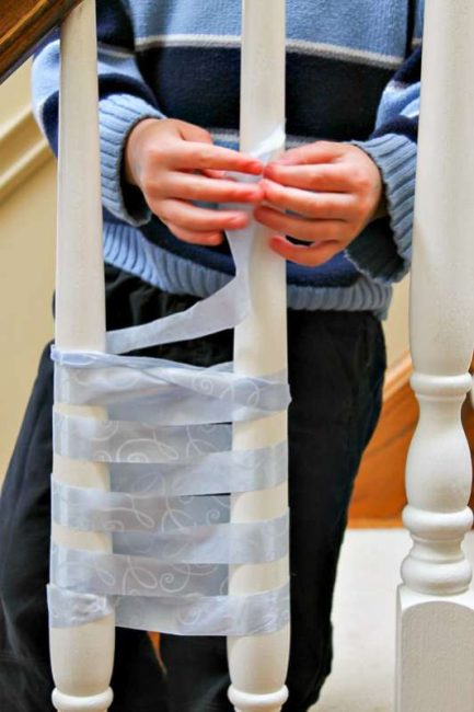 A big way to teach kids to weave using the staircase