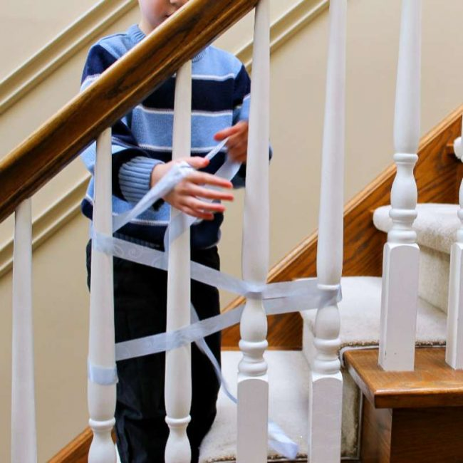 learn all about weaving for kids by introducing it on staircase spindles